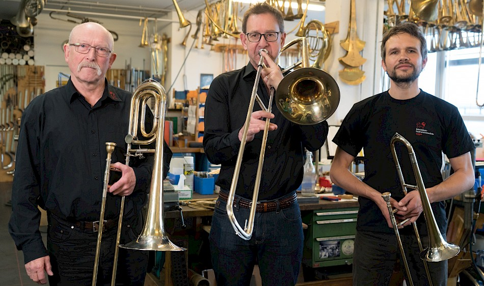 Replicas of German trombones by Egger in Basel. From left: Rainer Egger with a tenor bass trombone, Ian Bousfield with a tenor trombone, and Alex Schölkopf with an alto trombone.