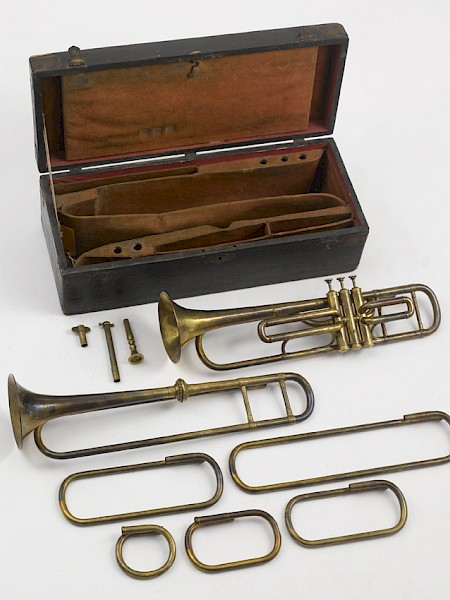 Case with a natural trumpet and a valve trumpet by Courtois, ca 1855. With shank in G and crooks in F, E, Eb, D and C.